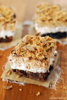 This Butterfinger Ooey Gooey Bars recipe has three delicious layers of brownies, marshmallow cream and Butterfinger Rice Krispie Treats!
