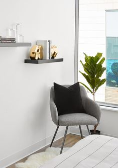 This bright bedroom corner offers a cozy chair perfect for reading - or holding the clothes that didn't quite make it back to the closet. Bedroom Reading Chair, Small Chair For Bedroom, Small Grey Bedroom, Bedroom With Sitting Area, Bedroom Corner, Bedroom Sets, Bedroom Decor, Cozy Chair, Chair Cushions