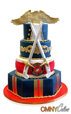 Marine Corps Graduation Cake   A Marine Corps Graduation is a serious and prestigious affair and we were honoured to create this cake for one young graduate! The cake was styled in the tradition of the Marine Blue Dress uniform which is worn for this occasion.  In order to cater for a huge event of 80 guests, we built up a cake of four tiers, each one reflecting different elements of the uniform and the occasion.