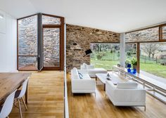 Stone wine cellar converted into home by Cubus Arquitectura