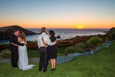 Newlyweds and parents enjoying a special wedding day sunset at Albion River Inn.