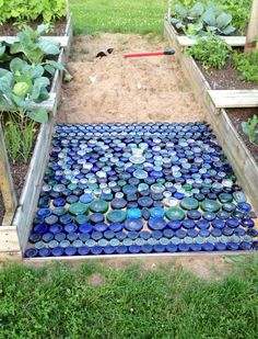 Colored glass bottle bottom path for your garden. In process.