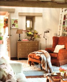 dream living room. love the orange chair