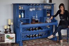 An antique upright grand piano turned into a bar and then painted with Annie Sloan Napoleonic blue chalk paint®. A wash of Paris Grey was then added to the details. This piece was done by CindyB.