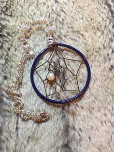 Hand wrapped, woven and painted navy dreamcatcher pendant with nickel free 18' chain and white glass pearl by EarthDiverCreations on Etsy https://www.etsy.com/ca/listing/482541496/hand-wrapped-woven-and-painted-navy