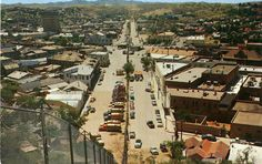 Nogales, Sonora, Mexico, is to the left of the fence. Nogales, Arizona, USA to the right. Where US Hwy 89 connects with Mexican Federal 15, c. 1950s Photo credit: William Bird