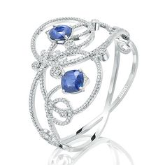 Boodles. BRACELETS. Sweet Pea. In this suite vivid blue Ceylon sapphires rest in sparkling diamond tendrils decorated with briolette diamond dew drops. The Sweet Pea design is inspired by this flower's curling, spring-like vines, which you can wind around your finger while admiring their sweet scented blooms. These twisting contours are the focal point of this very intricate collection.