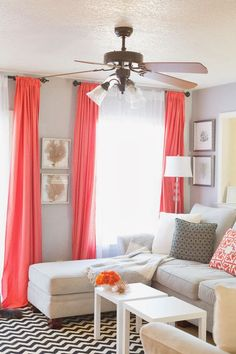 Sheets for drapes! Pop of coral. living room. home decor and interior decorating ideas.