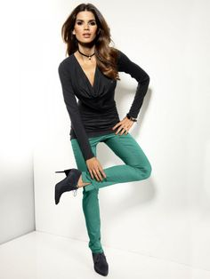 black shirt, high-heeled ankle boots and a slim fit trousers