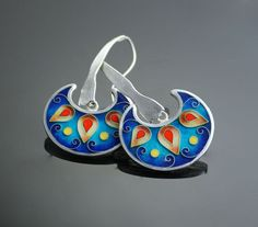 "The earrings were created using very ancient technique of enameling-Cloisonné (French-""partitions)    I created this design by forming fine silver wires"