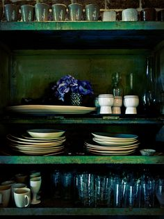 Plates, platters, cups, and flowers.