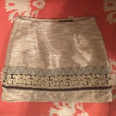 GORGEOUS embroidered skirt Gorgeous gold and silver skirt with gold, black, and red embroidering. I only wore this skirt once to a Christmas party and got so many compliments on it!! The brand is a boutique brand called English rose. English Rose Skirts