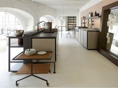 When Italian kitchen innovatorBoffi asked designer Patricia Urquiola to come up with a modular kitchen system, she gave a think and came up with a system