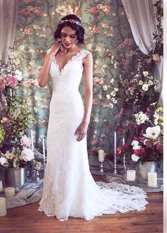 "Cap Sleeved V neck Mermaid Lace Wedding Gown, Low back, Buttons, Train, ""Rosaline"" Wedding Gown from Schone Bridal. $2,798.00, via Etsy."
