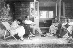 Virginia Woolf outside her summer house with Maynard Keynes, Angelica Bell, Vanessa Bell, and Clive Bell, 1930s
