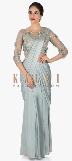 Buy Online from the link below. We ship worldwide (Free Shipping over US$100) Click Anywhere to Tag Grey satin pre-stitched saree with embellished blouse on 3D flowers only on Kalki Make a swarming impact in this grey satin pre-stitched saree. Showcasing the purity of the saree, it is kept minimal on work highlighting the pallu with some embellishments. The ready stitched blouse in net is adorn using the zari and moti work featuring the 3D flowers to beautify it even more.