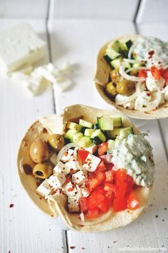 Greek Salad Wraps With Tzatziki _ Salad of: tomato, cucumber, onion, feta cheese, garlic spiced olives. Add some of the salad and tzatziki onto an amaranth or whole wheat tortilla and eat like a wrap. I Love Food, Good Food, Yummy Food, Vegetarian Recipes, Cooking Recipes, Healthy Recipes, Fun Recipes, Mediterranean Recipes, Greek Recipes
