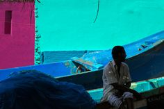 https://flic.kr/p/xwRCw3   Colors. Kanyakumari, India   Silhouette of a fisherman sitting on a boat by a colorful setting in Kanyakumari, Tamil Nadu, India.
