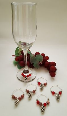 Check out this item in my Etsy shop https://www.etsy.com/listing/281228438/grape-wine-charms-set-of-6 Grape Wine Charms