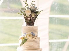 Wisteria Flowers and Gifts | Rustic Dream wedding cake with floral topper