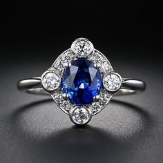 I'd take something like this for an engagement ring...doesn't have to be a diamond center :) 1.44 Carat Sapphire and Diamond Ring