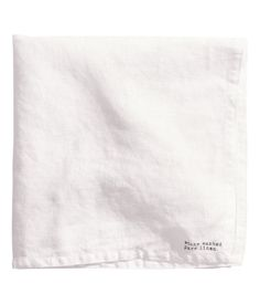 Dark gray. PREMIUM QUALITY. Napkin in washed linen with printed stamp motif and double-stitched edges.