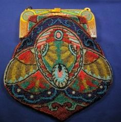 Art Deco Egyptian Revival Bakelite Beaded Bag, the frame with multi-color Egyptian motifs suspending the beaded bag depicting a winged scarab
