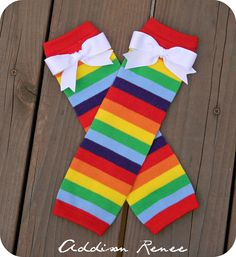 leg warmers - childrens rainbow leg warmers with white bows at the knee. $10.50, via Etsy.
