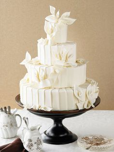 An all-white cake makes a very glamorous statement: http://www.bhg.com/wedding/cakes/creative-wedding-cakes/?socsrc=bhgpin010714ivorysplendor&page=1