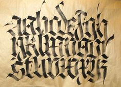 Dry-brush Fraktur. The Fraktur style is characterized by pointed arches, but curved at the sides, giving a less extreme form of Gothic than 'Textura'. Calligraphers will notice that there is a lot of pen angle manipulation in this alphabet, (this means dynamic changes of the angle of the nib within strokes).