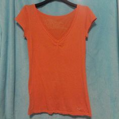 Orange Hollister Top This comfortable orange Hollister shirt is a great summer or spring day wear! It is a size medium and is made with 96% cotton and 4% spandex. It is a comfortable top that goes with anything. Let me know if you are interested! :) Hollister Tops Tees - Short Sleeve
