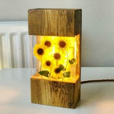 Finally got the first of the sunflower lamps finished! Such a warm glow even on . - Holz - ideen lampe Finally got the first of the sunflower lamps finished! Such a warm glow even on . Wooden Lamp, Wooden Diy, Diy Wood, Diy Resin Crafts, Wood Crafts, Diy Resin Lamp, Epoxy Resin Wood, Resin Furniture, Ideias Diy
