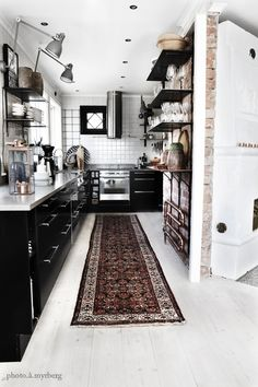 #black on #white, with #industrial accents #kitchen #ethnic_rug