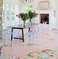 Shabby chic floors and lucite chairs.