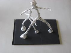 alberto giacometti style sculptures with foil and pipe cleaners