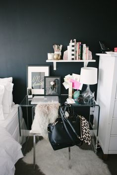 For the smaller urban apt, using a desk as a nightstand is the perfect solution to creating a home office.