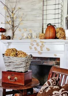 A tree made of backyard sticks and raffia adds some height to this country-chic mantel. Add color with pumpkins, leaves, and barnwood boards.
