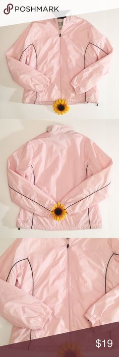 Light pink New Balance windbreaker jacket XL Very good used condition NB windbreaker. Light pink with black trim. No flaws that I see. Two hidden side zippers where the trimming is. Total length- approximately 23.5 inches, bust- approximately 21.5 inches, sleeve length- approximately 25 inches. New Balance Jackets & Coats