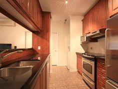 Stainless steel appliances, granite counter tops, wood cabinetry (6/9)