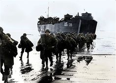 American troops disembark onto the sands of Normandy, 1944. (Colorised black and white print). Artist Unknown - pin by Paolo Marzioli