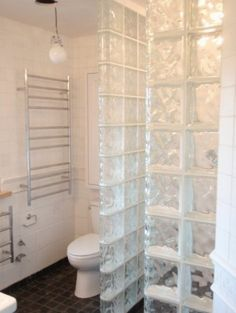 Glass blocks come in a variety of designs.  They sparkle even after you shower.  You just walk away and don't look back.