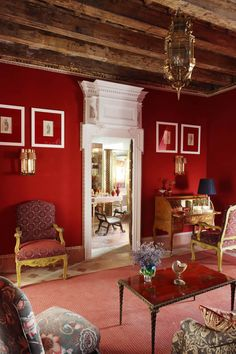 Red living room walls, white trim, stained ceiling beams