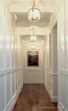 opal-design-group-wainscoting-hall-coffered-ceiling-brass-pendant-lanterns-white-gloss-paint