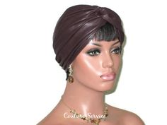 """Plum Leather Turban, Handmade by Couture Service *Note: This plum turban is VERY dark, similar to dark brown in color.Soft, cowhide leather fused to a soft rayon backing.Front twist, top-stitched hem, completely hand gathered back with reinforcing, finished seams, finished edges.Medium fits 22 1/2 inch head. (57.15 cm)Mannequin is wearing Medium. Her head is 22"""".Meticulously hand made."""