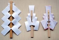 Gohei (御幣), onbe (御幣), or heisoku (幣束) are wooden wands, decorated with two shide (zigzagging paper streamers) used in Shinto rituals. The shrine priest or maiden attendants (miko) use the gohei to bless or sanctify a person or object in Shinto rituals. The gohei is used for some ceremonies to cleanse a sacred place in temples and to bless, or exorcise any object that is thought to have negative energy.
