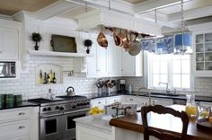 Traditional Kitchen by Jules Duffy Designs niche above cooktop and marble top across from stove for rolling out cookies