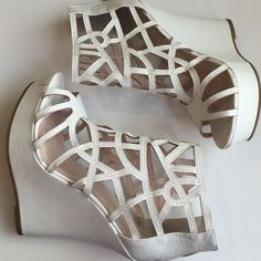 Charlotte Russe white cage wedges These beautiful wedges are perfect for any night out! No matter the occasion, you'll sure stand out! Charlotte Russe Shoes Wedges