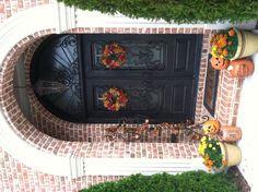 Fall decor, wrought iron door