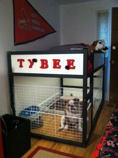 Materials: Kura bed with mattress and slatted bed base, Dioder multipurpose lighting, Expedit shelf, wire cubes, zip ties, paint Description: I wanted a bigger cage for my dog that I could turn into her own room. I wanted a cage big enough to provide enough space for her bed, toys, food/water, etc. The Kura bed …