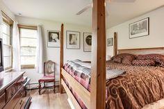 Master bedroom has hardwood floors